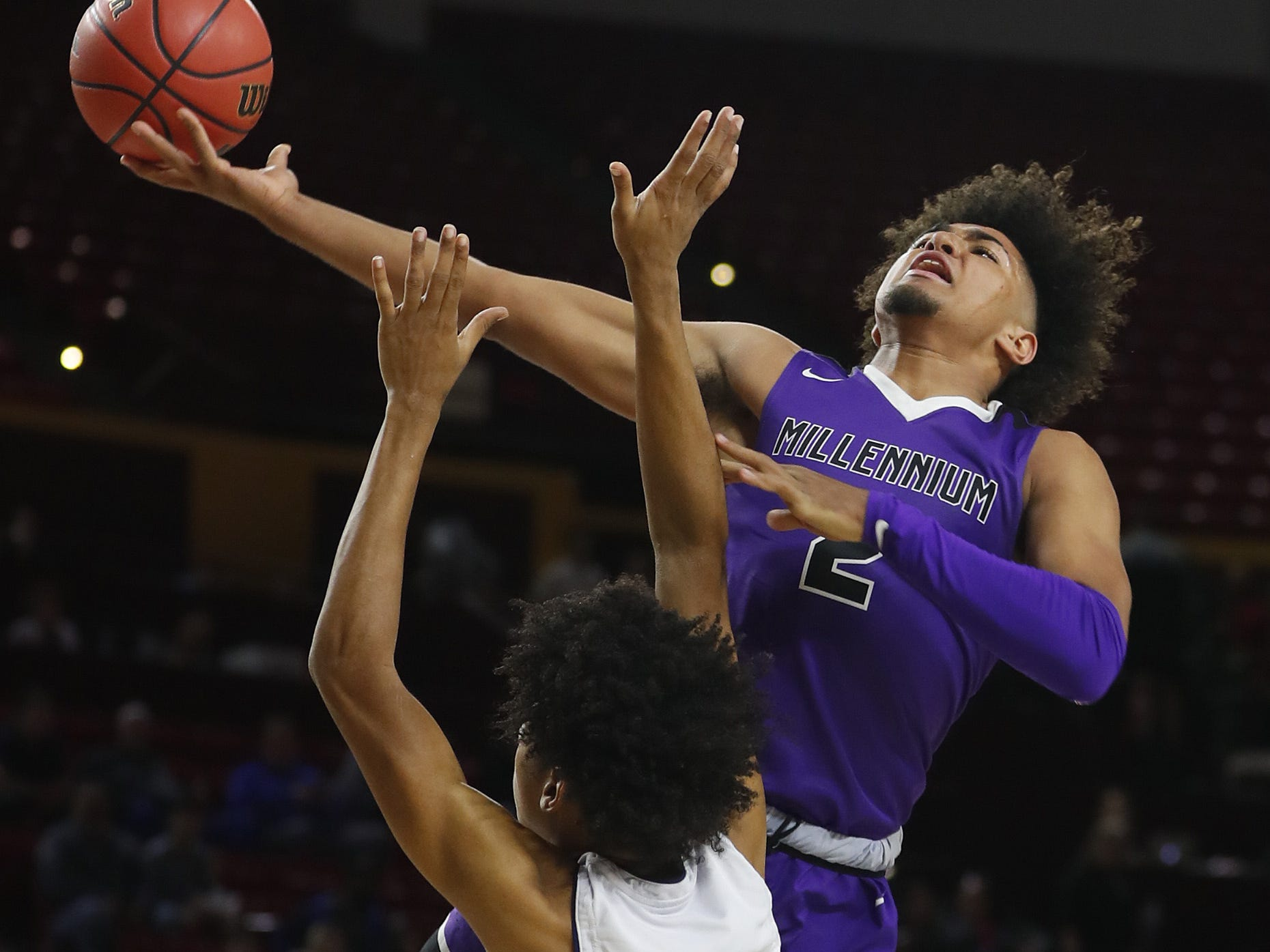 Millennium's Jalan Early (2) goes up for a layup against Apollo's Tramane Lee (11) during the 5A boys basketball state semifinal game at Wells Fargo Arena in Tempe, Ariz. on February 18, 2019.