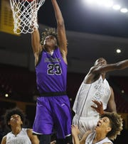 Millennium's DaRon Holmes (23) dunks against Apollo's Emmanuel Taban (23) during the 5A boys basketball state semifinal game at Wells Fargo Arena in Tempe, Ariz. on February 18, 2019.
