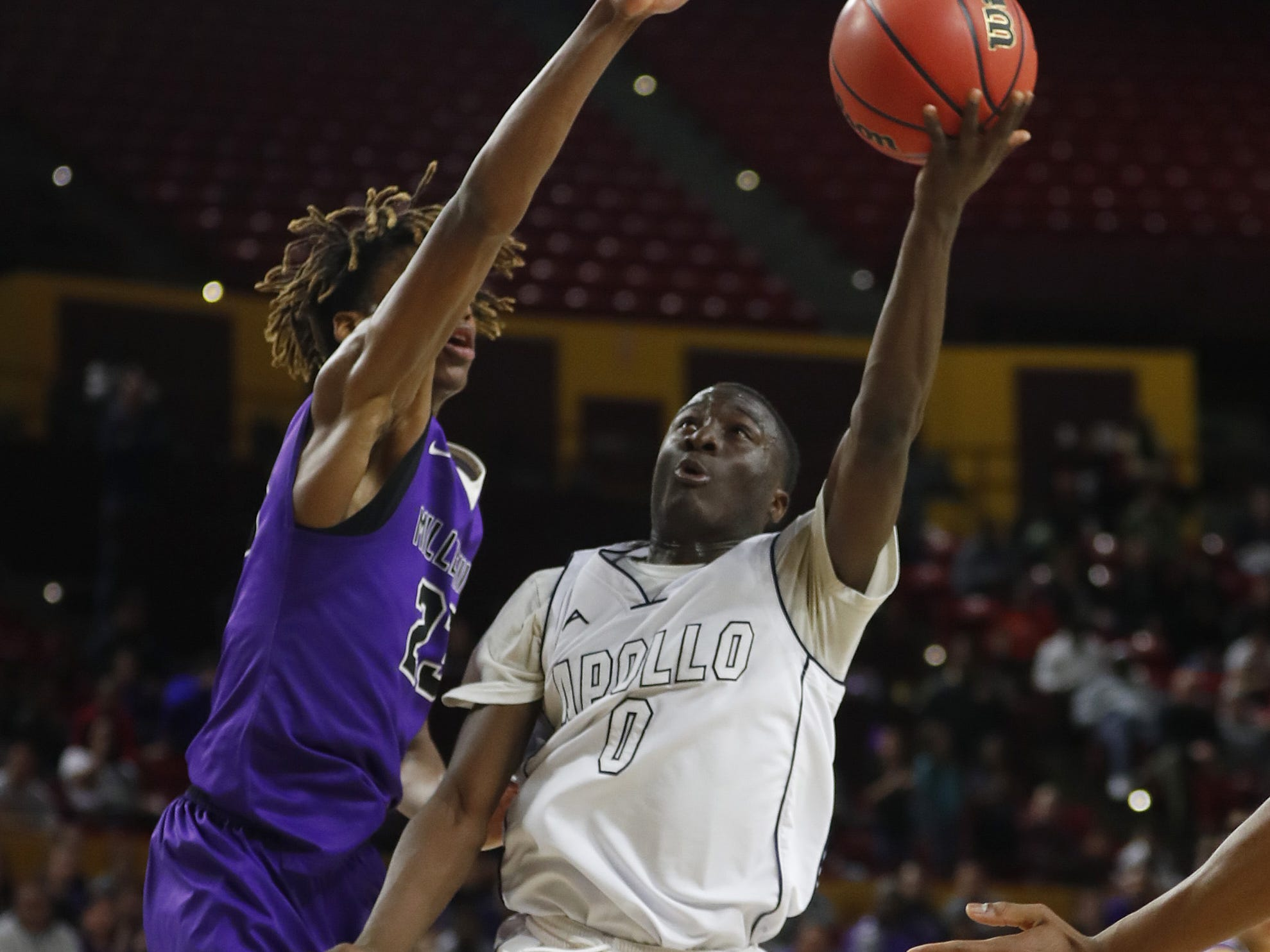 Millennium's DaRon Holmes (23) blocks a layup from Apollo's Gabriel Nyawumenya (0) during the 5A boys basketball state semifinal game at Wells Fargo Arena in Tempe, Ariz. on February 18, 2019.