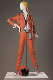 Karl Lagerfeld; Coral color motorcycle-style jacket, coral pants, blue sneakers; 2002; cotton and polyamide; 21 1/4 in. (54 cm); Collection of Phoenix Art Museum, gift of Mrs. Kelly Ellman