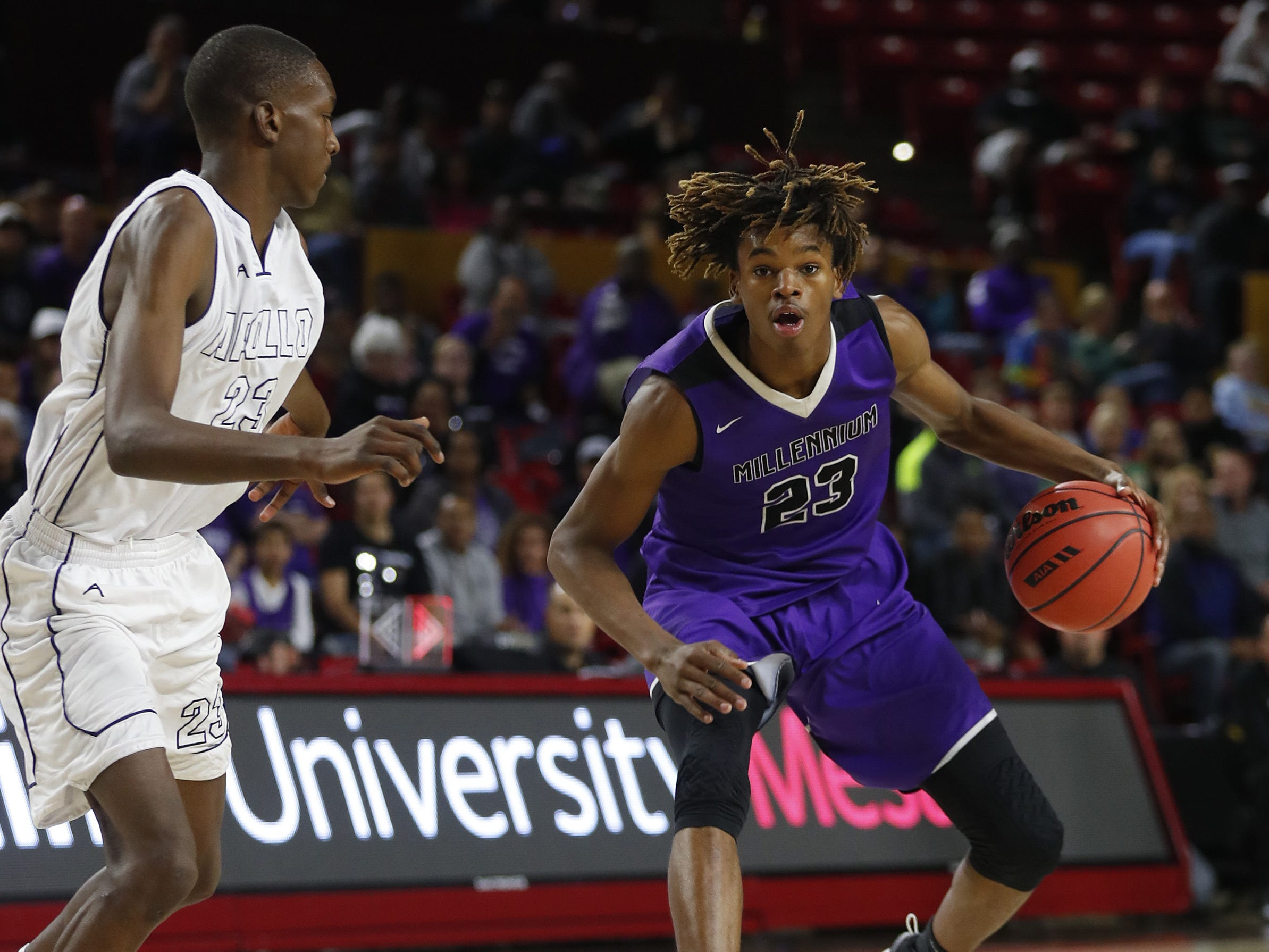 Millennium's DaRon Holmes (23) dribbles against Apollo's Emmanuel Taban (23) during the 5A boys basketball state semifinal game at Wells Fargo Arena in Tempe, Ariz. on February 18, 2019.