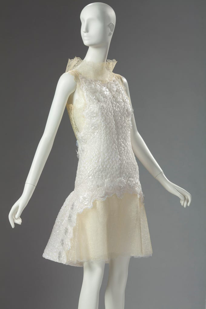Karl Lagerfeld, Dress, 2012.  Polyester, acrylic, silk and nylon with polyurethane lace and a silk and nylon lining. Collection of Phoenix Art Museum, gift of Neiman Marcus