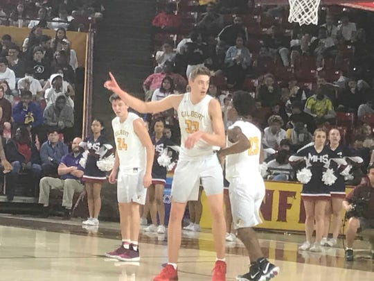 Gilbert's Carson Towt leads his team during the 5A boys basketball semifinal on Monday.