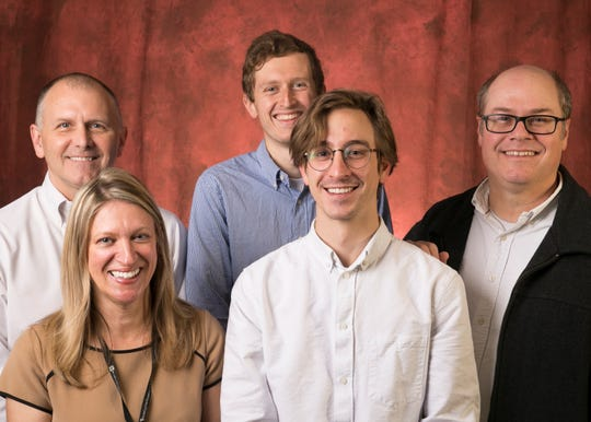 """The Arizona Republic team behind """"The Charter Gamble"""" won a George Polk Award for their 2018 reporting on charter schools. From left, reporters Craig Harris, Anne Ryman, Alden Woods and Justin Price, and investigative editor Michael Squires."""