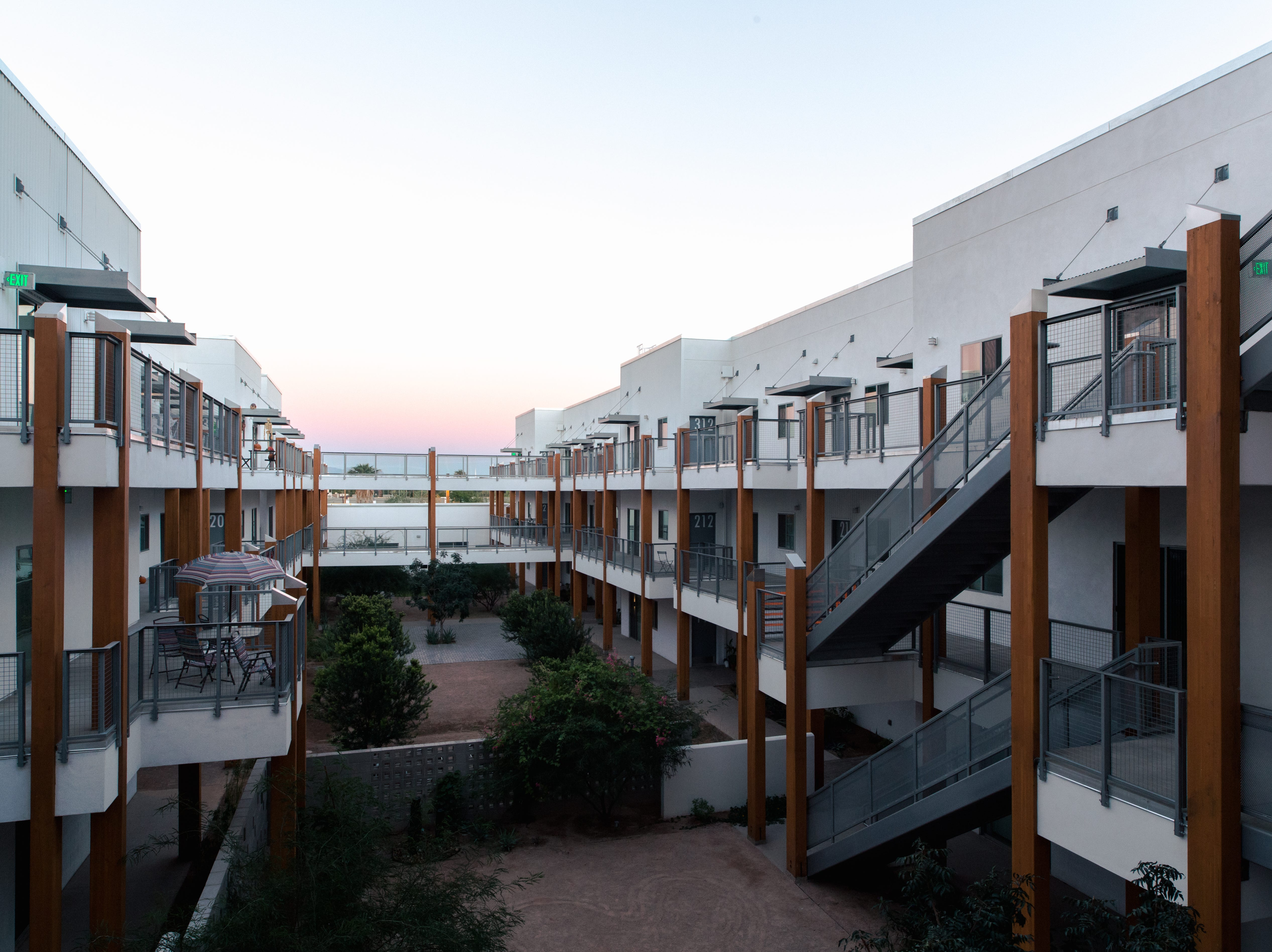 Exterior staircases, common outdoor spaces that revolve around light and native species, shade and walkways that are tailored to a desert climate are among the features unique to the Artspace Lofts Mesa complex.