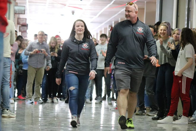 Port Clinton High School gave sophomore diver Alaina Dackerman a proper send-off on Tuesday as she heads to the state championships, which begin Wednesday. She is joined by Coach Danny Diaz.