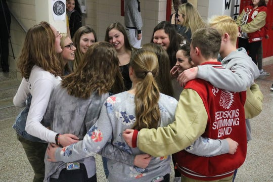 Port Clinton diver Alaina Dackerman, a sophomore, celebrates with her teammates Tuesday prior to heading to the state championships, which start on Wednesday.