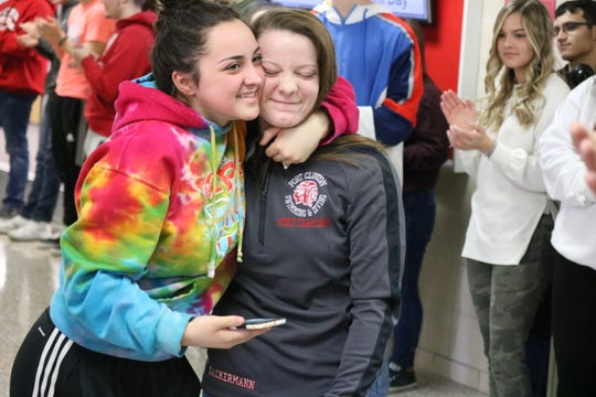 Port Clinton sophomore diver Alaina Dackerman, right, celebrates with a friend Tuesday prior to heading to the state championships.