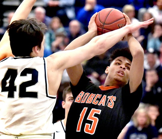 Northeastern's Maurice Capo looks for the basket with pressure from West York's Gabe Mummert during a District 3 Class 5-A boys' basketball first-round game at West York Monday, Feb. 18, 2019. Bill Kalina photo