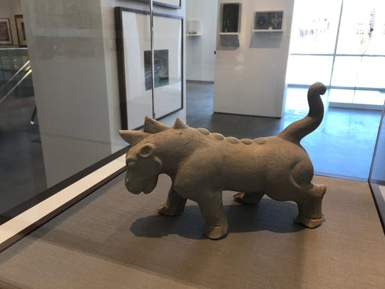 A three-horned rhinoceros is one of the pieces in the museum inside the new University Arts Building.