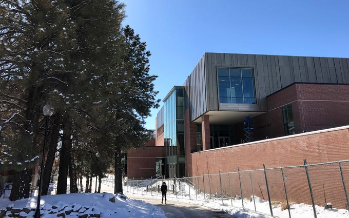 A student is seen walking past the new University Arts Building on the campus of the University of Nevada, Reno on Feb. 19, 2019.