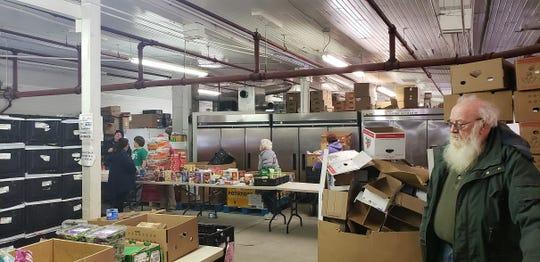 Volunteers help distribute food Saturday at Gateway Hunger Relief Center.