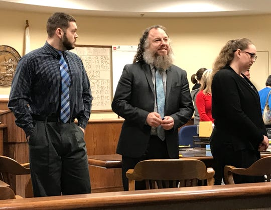 Robert McBroom, left, stands next to his defense attorney Shon Northam, center, and co-defendant Cynthia McBroom, right, on Tuesday, Feb. 19, 2019, before a jury found the McBrooms guilty of second-degree murder and assault on a child causing death.