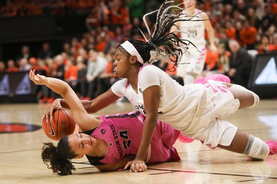 Oregon's Ruthy Hebard, right, and Oregon State's Destiny Slocum, left, scramble for a rebound during the first half of an NCAA college basketball game in Corvallis, Ore., Monday, Feb. 18, 2019. (AP Photo/Amanda Loman)