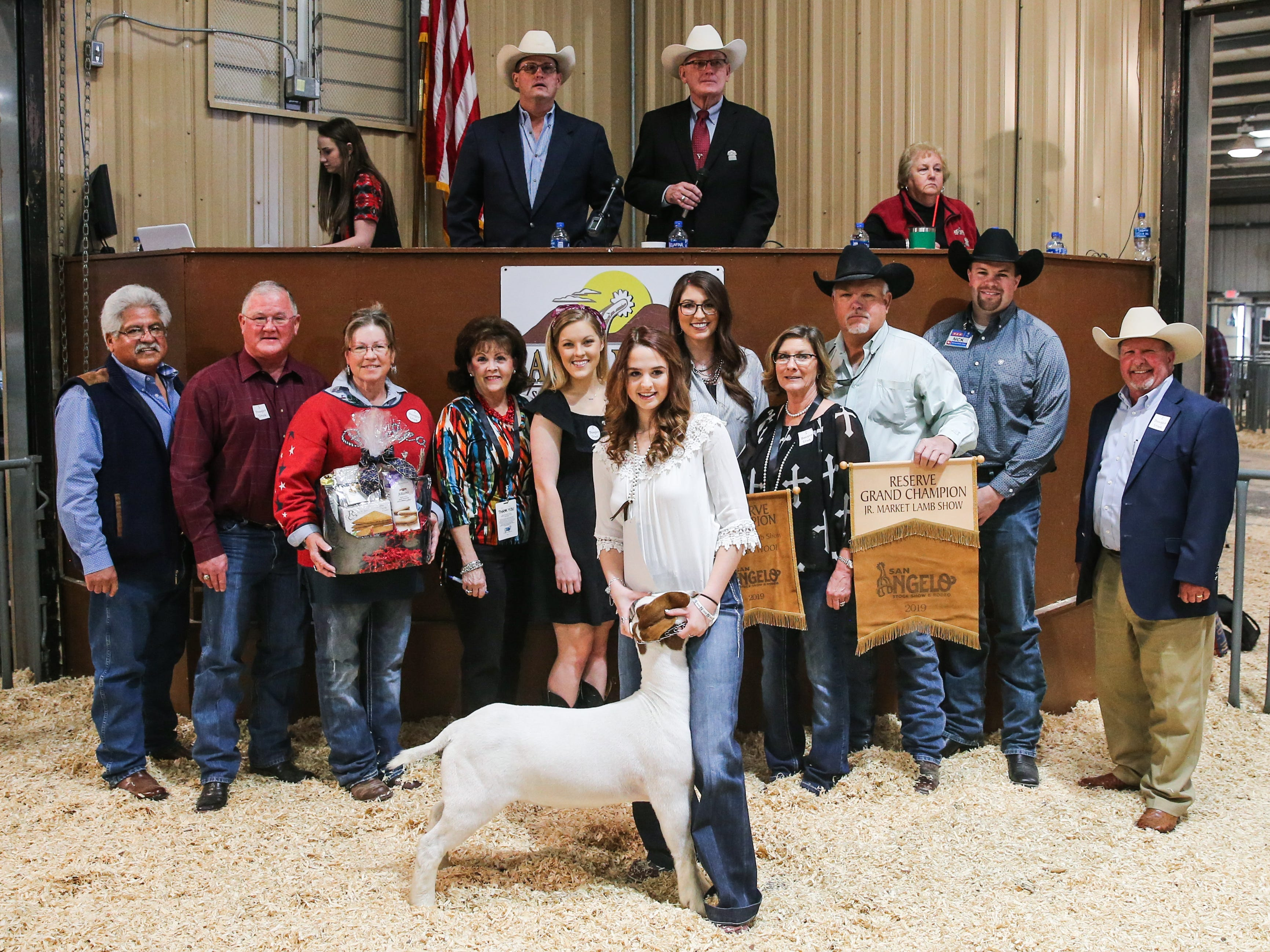Reserve Grand Champion Goat exhibited by Maci Alexander of Anderson Shiro FFA, sold for $12,000.From left to right: Raymond Meza, Twin Mountain Fence Company; Lindy Jordan, First Financial Bank; Dawn Foster, No Step Ranch; Vicki Loso, 1st Community Credit Union; Caylan Gandy, Gandy Ink; Darcy Weishuhn, The Bank & Trust; Maci Alexander, exhibitor; Kathy Frey, Frey Show Goats; Doug Frey, Frey Show Goats; Nick George, H-E-B; Todd Price, Jim Bass Ford. Not pictured: Anonymous Buyer & Weatherby Ranch.