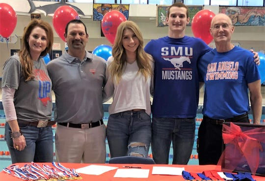 San Angelo Central swimmer Riley Hill poses with family and head coach David Hague after signing a letter-of-intent with SMU on Monday, Feb. 18, 2019.