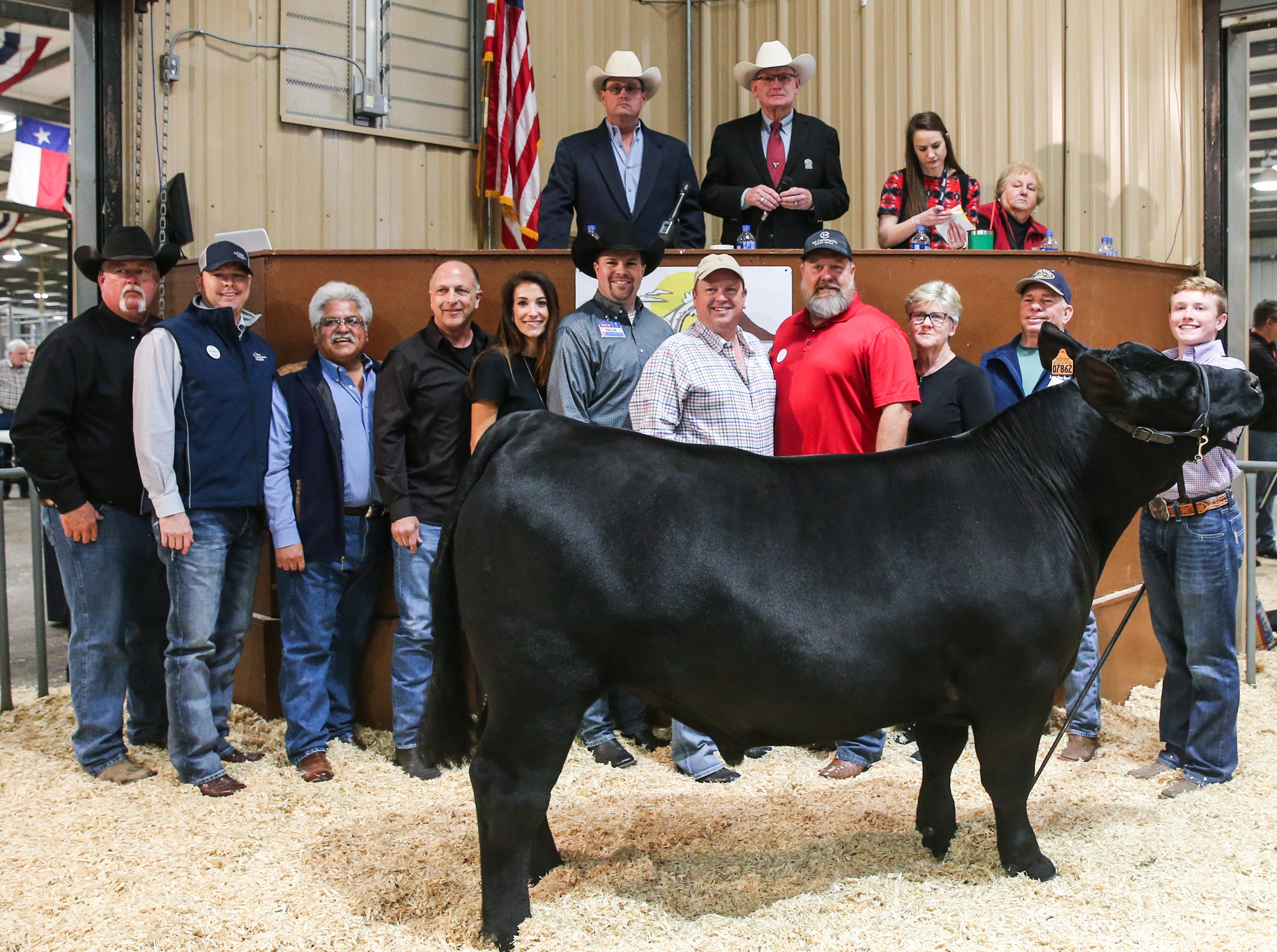 Grand Champion Steer exhibited by Tristan Himes of Sterling County 4-H sold for $37,500.00.From left to right: Mike Martin, Goode Construction; Chris Evatt, First Financial Bank; Raymond Meza, Twin Mountain Fence; Phil Gandy, Gandy Ink; Brie Perks, Rocking Chair Ranch; Nick George, H-E-B; James Sanderson, Armstrong, Backus, & Company; Bill Nikolauk ,1st Community Federal Credit Union; Pattie Self, Automatic Fire Protection; Chuck Jones, Lone Star Beef; Tristan Himes (exhibitor); London Bird (holding banner)