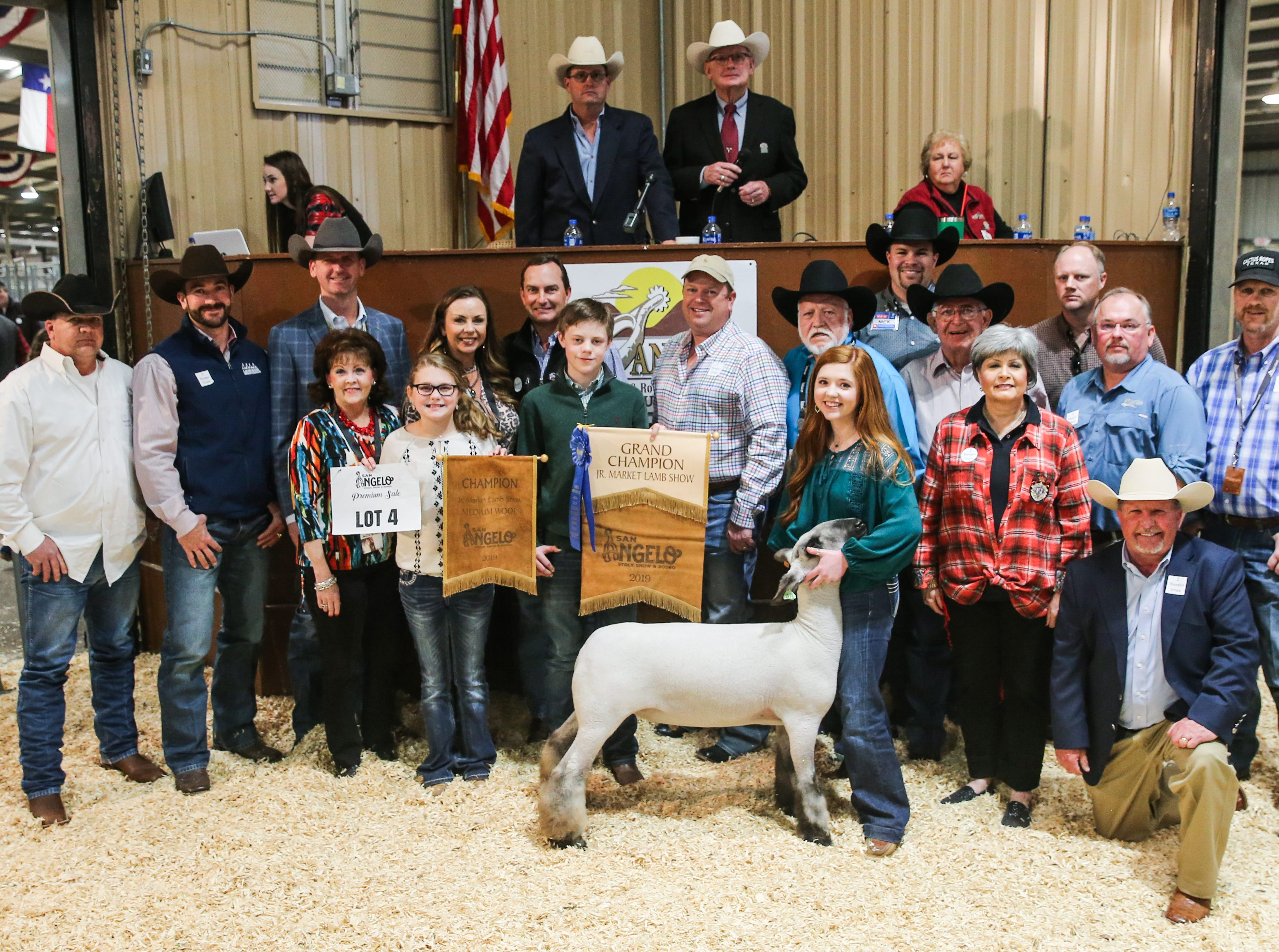 Grand Champion Market Lamb exhibited by Carlye Winfrey of Seminole FFA, sold for $23,000.From left to right: Britt Wilhem, Auto Wrangler; Cooper Hogg, City Lumber; Sean Carter, Gandy Ink; Vicki Loso, 1st Community Federal Credit Union; McKinley Clem (holding banner); Bridget Carr, Bug Express; John Mayer, Mayer Ranch; Hudson Franklin (holding banner); James Sanderson, Armstrong, Backus & Company; Clay Cross, Cross County Construction; Carlye Winfrey (exhibitor); Nick George, H-E-B; Joe Wagley, Jody's Roofing; Toni Sudduth, Trans Texas Southwest Credit Union; Wade Franklin, Franklin Show Lambs; Randy Dupree, Capital Farm Credit; Todd Price, Jim Bass Ford; Guy Abbott, Glazer's Beer and Beverage.Not pictured: Weatherby Ranch, Drew Darby, WildLife Partners, LLC, Todd Donowho.