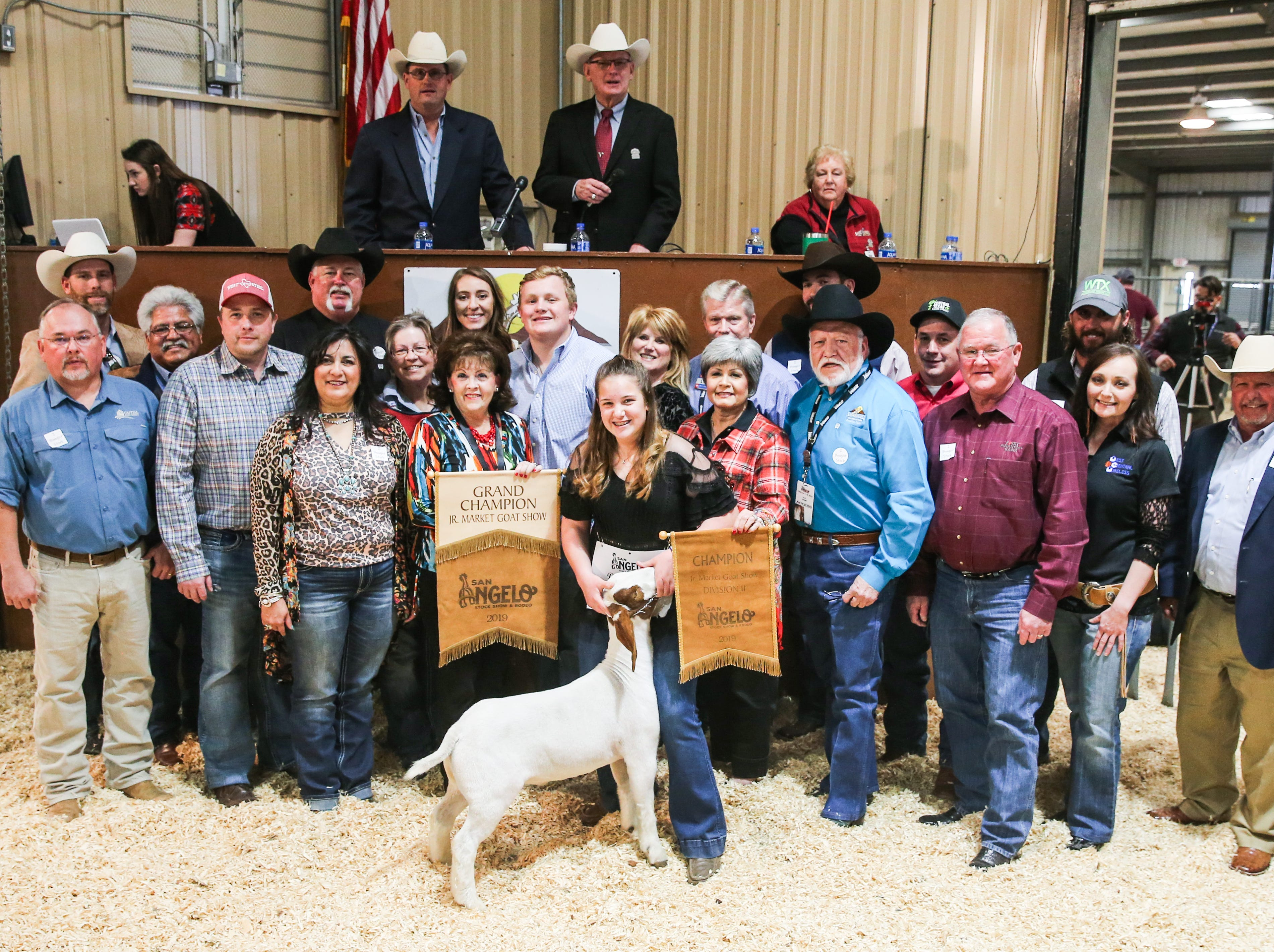 Grand Champion Market Goat exhibited by Dakota Martin with Mason County 4-H sold for $23,000.From left to right: Tyler Wright, Findaranch.com; Randy Dupree, Capital Farm Credit; Raymond Meza, Twin Mountain Fence Company; Bubba Davis, West Texas Steel; Mike Martin, Goode Construction; Sylvia Flores, San Angelo Standard Times; Dawn Foster, No Step Ranch; Maddie Seaver, Little Caeser's; Vicki Loso, 1st Community Federal Credit Union; Slone Stultz (holding banner); Dakota Martin (exhibitor); Raleigh Little, The Bank and Trust; Lynn Shipley, H-E-B; Toni Sudduth, Trans Texas Southwest Credit Union; Cooper Hogg, City Lumber; Clay Cross, Cross Country Construction; Wade Polk, Central Texas Farm Credit; Lindy George, First Financial Bank; Chris Knapp, WTX Landscape; Jennifer Armor, West Central Wireless; Todd Price, Jim Bass Ford. Not pictured: Acme Brick, Galen & Kristen Schwartz; Neff Livestock.