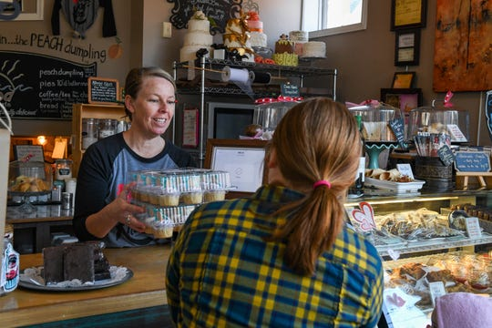 Michelle Thawley serves up sweet treats at Berlin's Baked Dessert Cafe on Tuesday, Feb. 19, 2019.