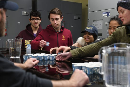 A group of environmental studies students from Salisbury University taste test the City of Salisbury's water vs. bottled water on Tuesday, Feb. 19, 2019 at the