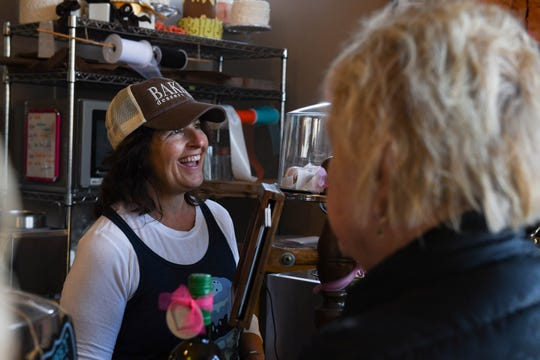 Robin Tomaselli chats with customers at Berlin's Baked Dessert Cafe on Tuesday, Feb. 19, 2019. As a small business owner, she said the potential minimum wage raise is worrying.