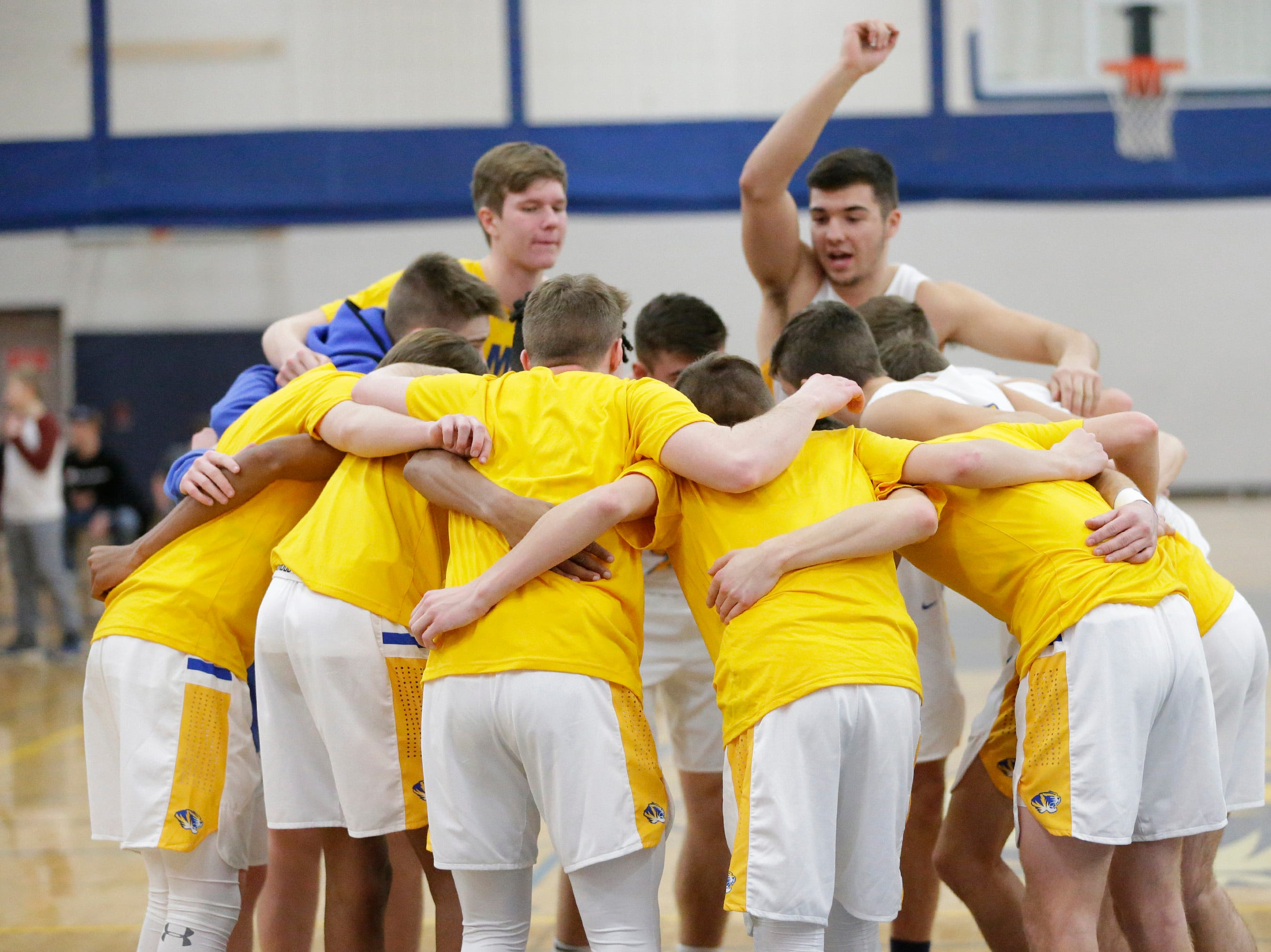 Howards Grove players huddle before action with Roncalli, Monday, February 18, 2019, at Howards Grove, Wis.