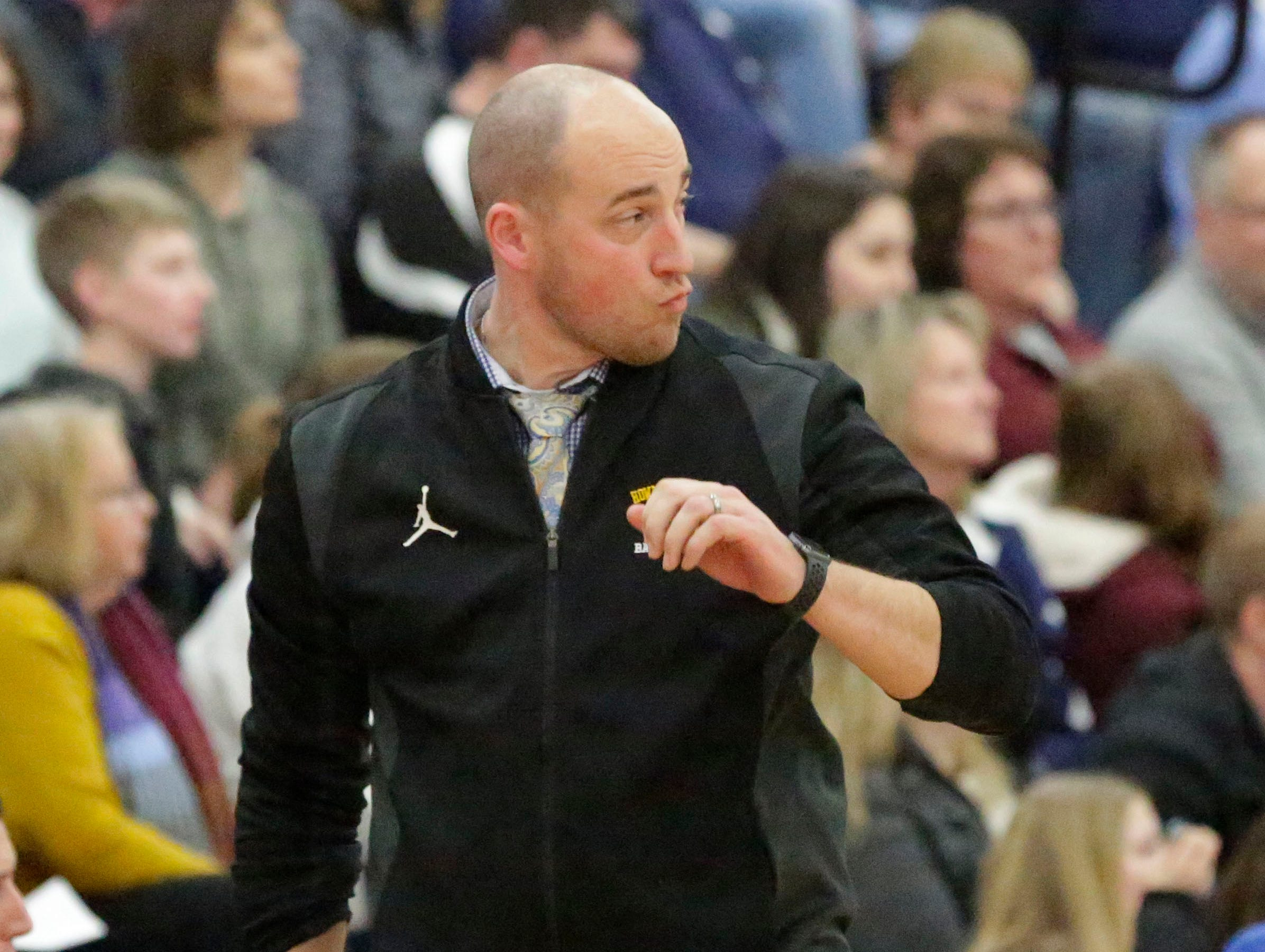 Howards Grove coach Wade Georgeff reacts to a referee call during action with Roncalli, Monday, February 18, 2019, at Howards Grove, Wis.