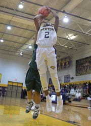 Benton's Qua Chambers goes up for a shot against Plaquemine Monday night.