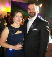 Revelers Drs. Ashley and Todd Flowers at Krewe Centaur Grand Bal, their first Mardi ball.