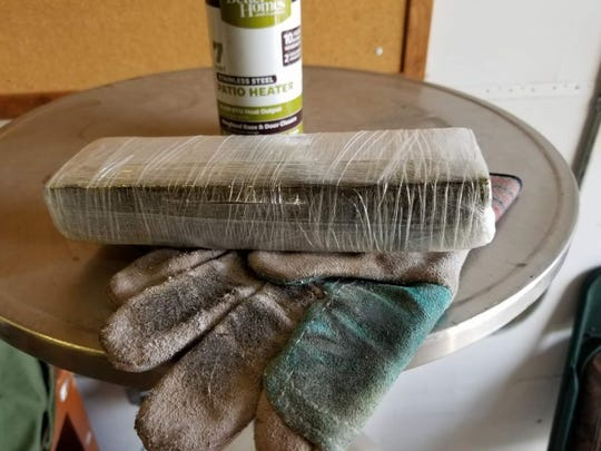 Officials say a bundle of marijuana was dropped into a Big Brothers Big Sisters donation bin in Springfield last year.