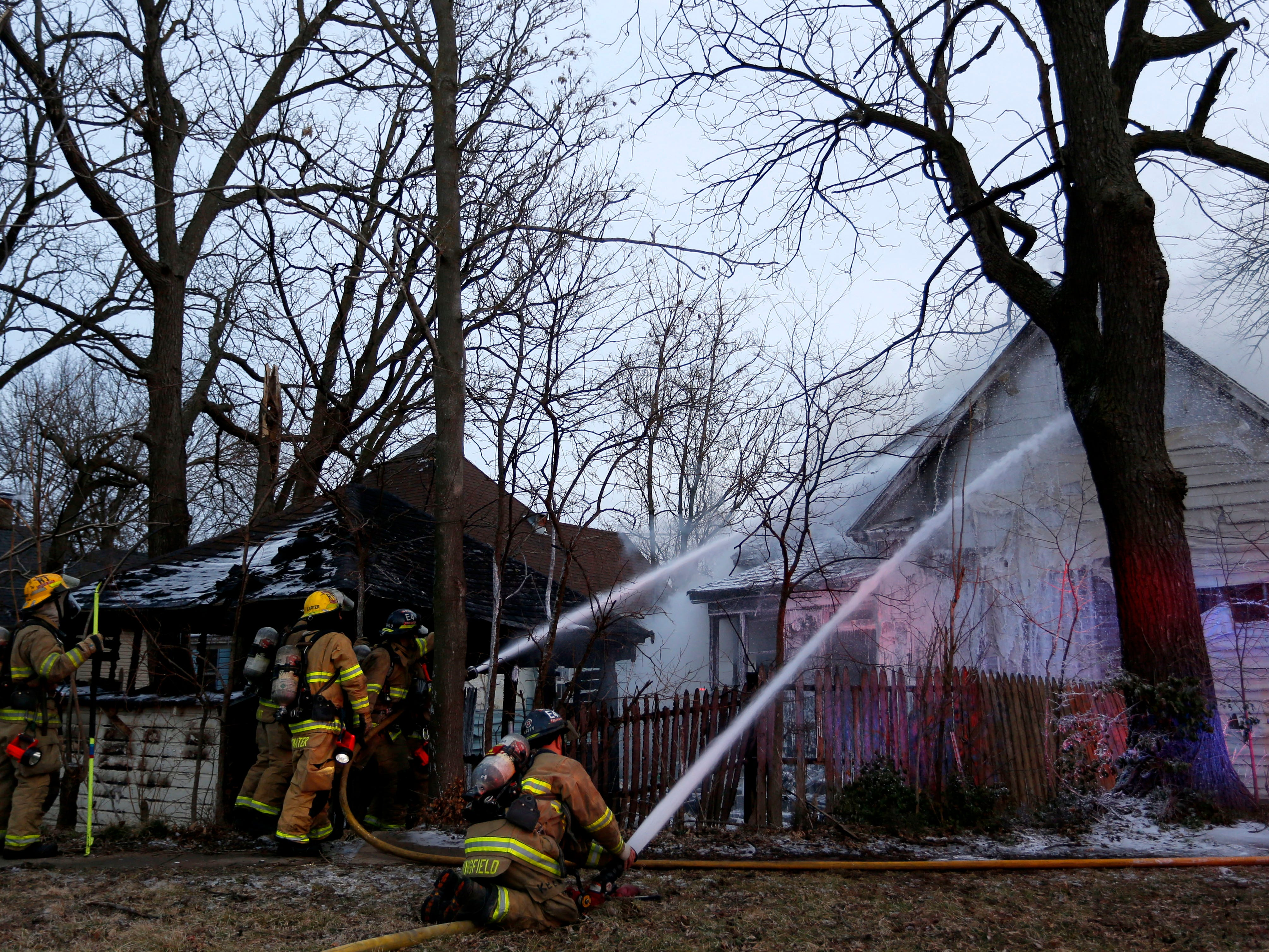 Firefighters battle a house fire at the corner of Commercial and Division Streets on Monday, Feb. 18, 2019. A homicide was reported at the house on Feb. 1.