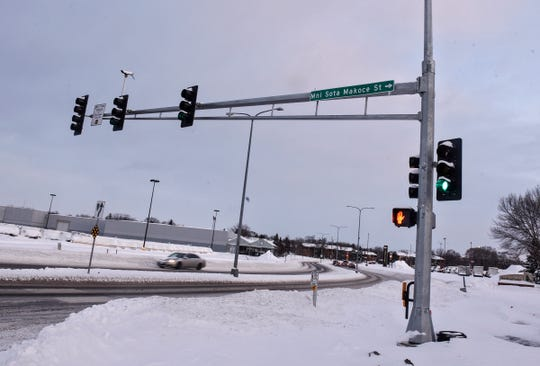 Traffic moves through the intersection of a newly-named street with 33rd Avenue South Tuesday, Feb. 12, near the Costco development in St. Cloud.