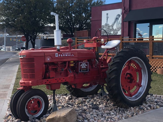 The red Farmall tractor parked in front of Hash House A Go Go in St. George, Utah.