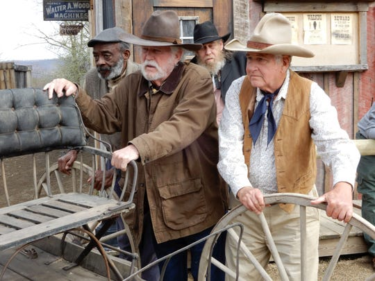 "Don Collier, at center, joins fellow cast members for a scene in ""Bill Tilghman and the Outlaws."""