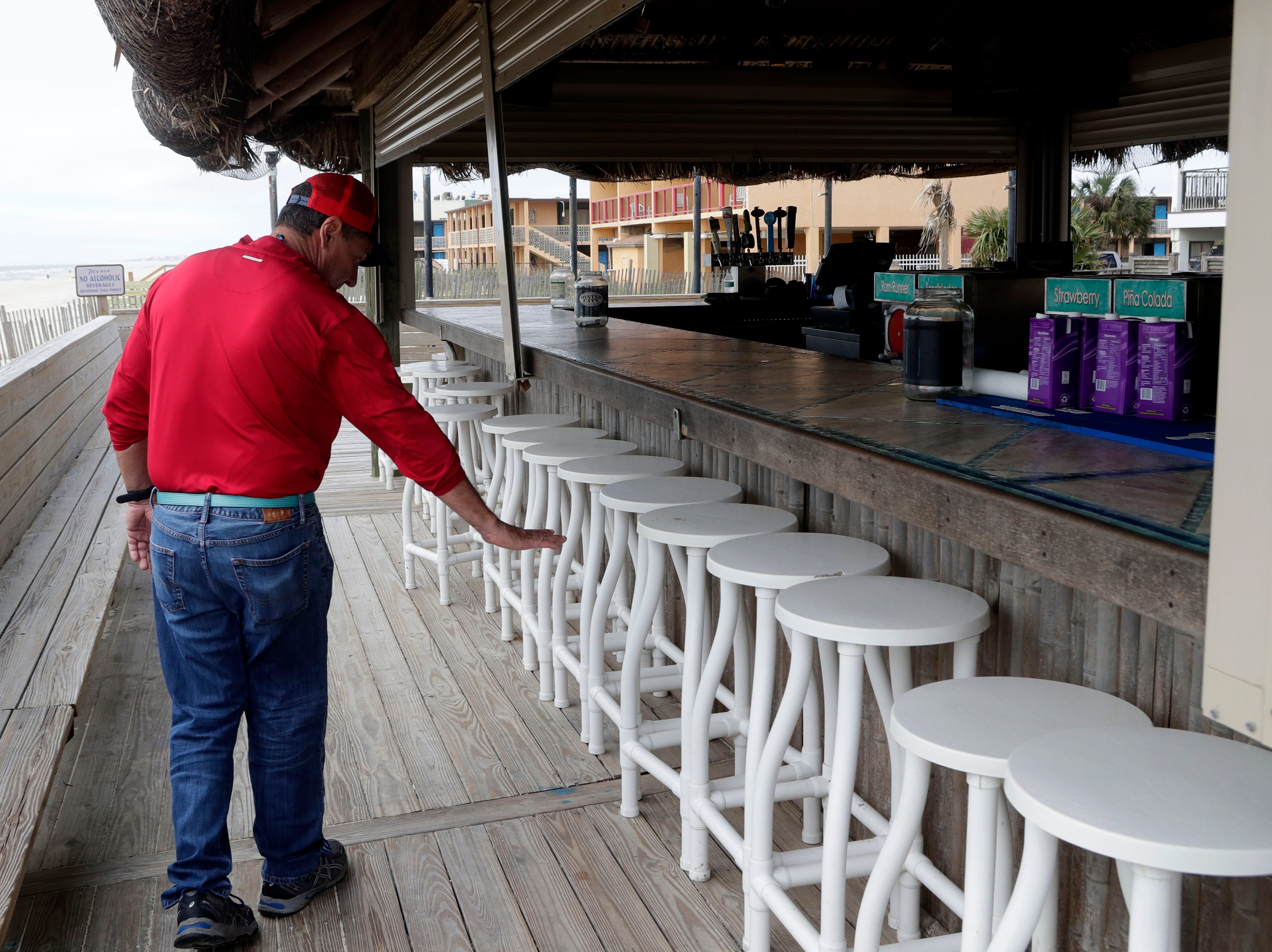 George Joanos, part owner of the Blue Parrot Ocean front Cafe on St. George Island, Fla., shows how high the water came during Hurricane Michael in Oct. 2018.