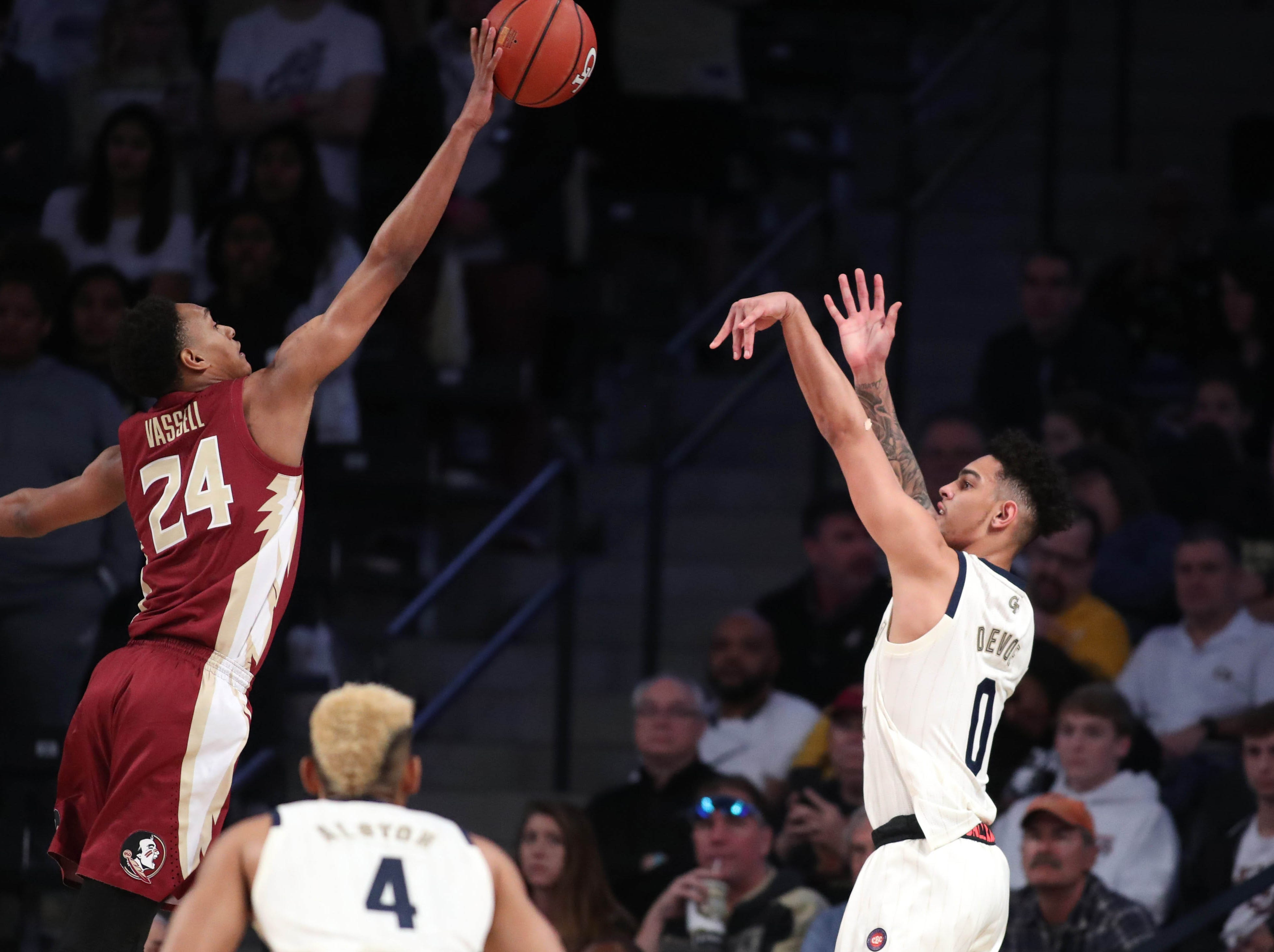 Feb 16, 2019; Atlanta, GA, USA; Florida State Seminoles guard Devin Vassell (24) blocks a shot attempt by Georgia Tech Yellow Jackets guard Michael Devoe (0) in the first half at McCamish Pavilion. Mandatory Credit: Jason Getz-USA TODAY Sports