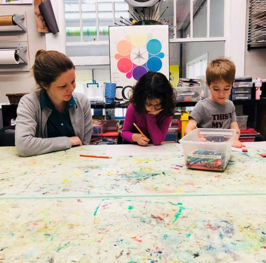 Apollonia Acevedo, center, draws in her new class at Brush & Palette, along with Ms. Karey Mortimer and Apollonia's BFF Jake Kampf.