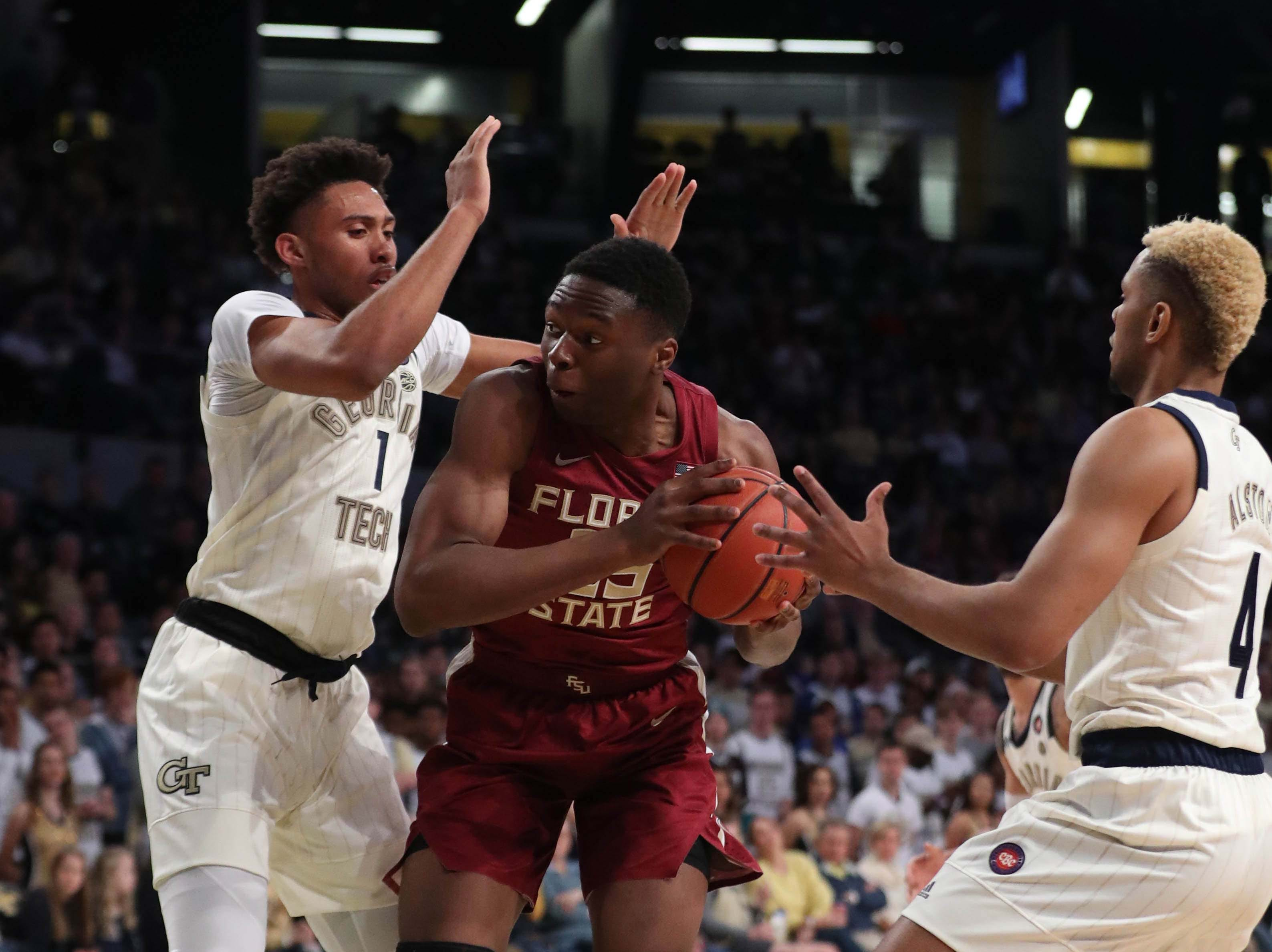 Feb 16, 2019; Atlanta, GA, USA; Florida State Seminoles forward Mfiondu Kabengele (25) is guarded by Georgia Tech Yellow Jackets forward James Banks III (1) and guard Brandon Alston (4) in the first half at McCamish Pavilion. Mandatory Credit: Jason Getz-USA TODAY Sports