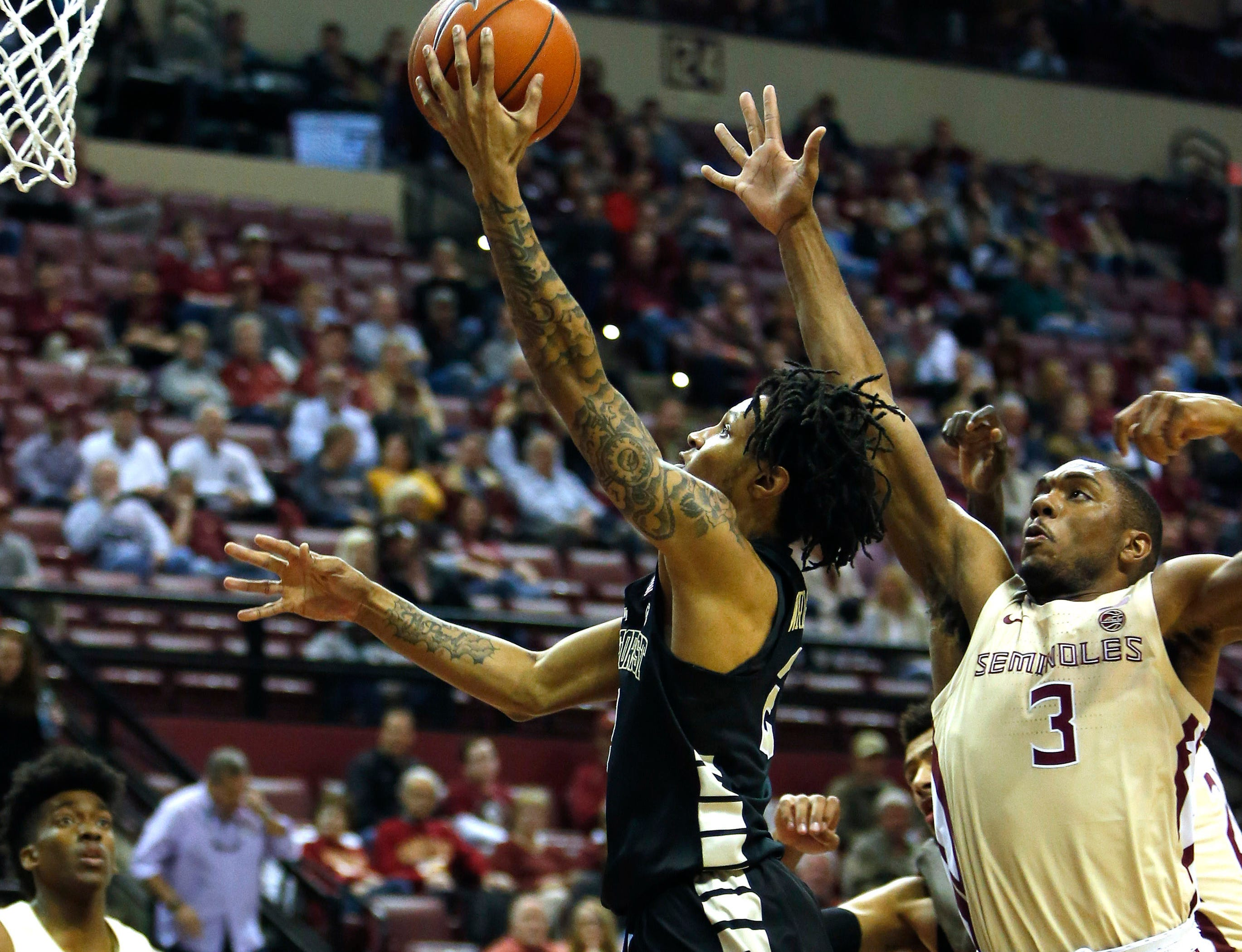 Feb 13, 2019; Tallahassee, FL, USA; Wake Forest Demon Deacons guard Sharone Wright Jr. (2) shoots the ball past Florida State Seminoles guard Trent Forrest (3) during the first half of action at Donald L. Tucker Center. Mandatory Credit: Glenn Beil-USA TODAY Sports