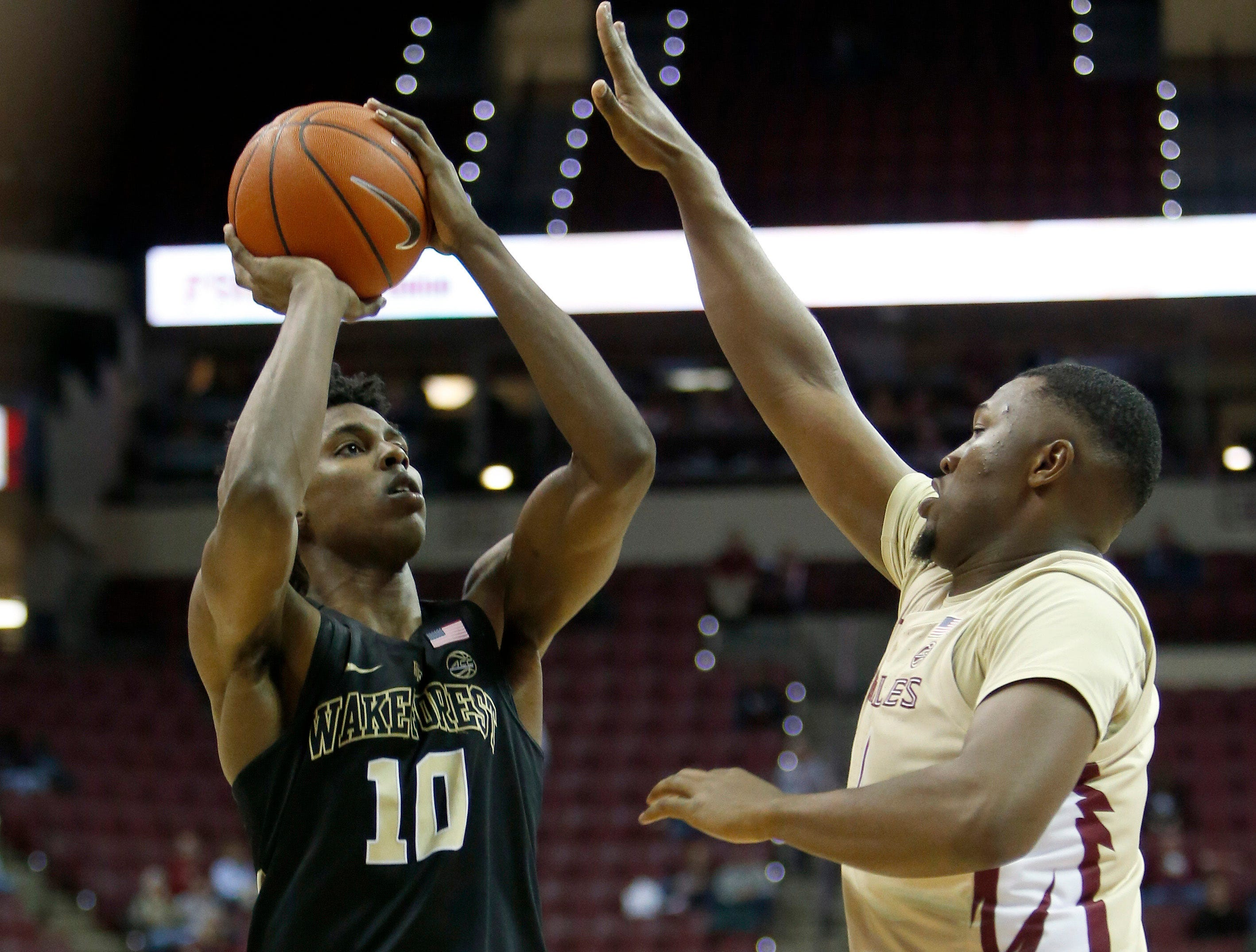 Feb 13, 2019; Tallahassee, FL, USA; Wake Forest Demon Deacons forward Jaylen Hoard (10) shoots the ball over Florida State Seminoles forward Raiquan Gray (1) during the second half at Donald L. Tucker Center. Mandatory Credit: Glenn Beil-USA TODAY Sports