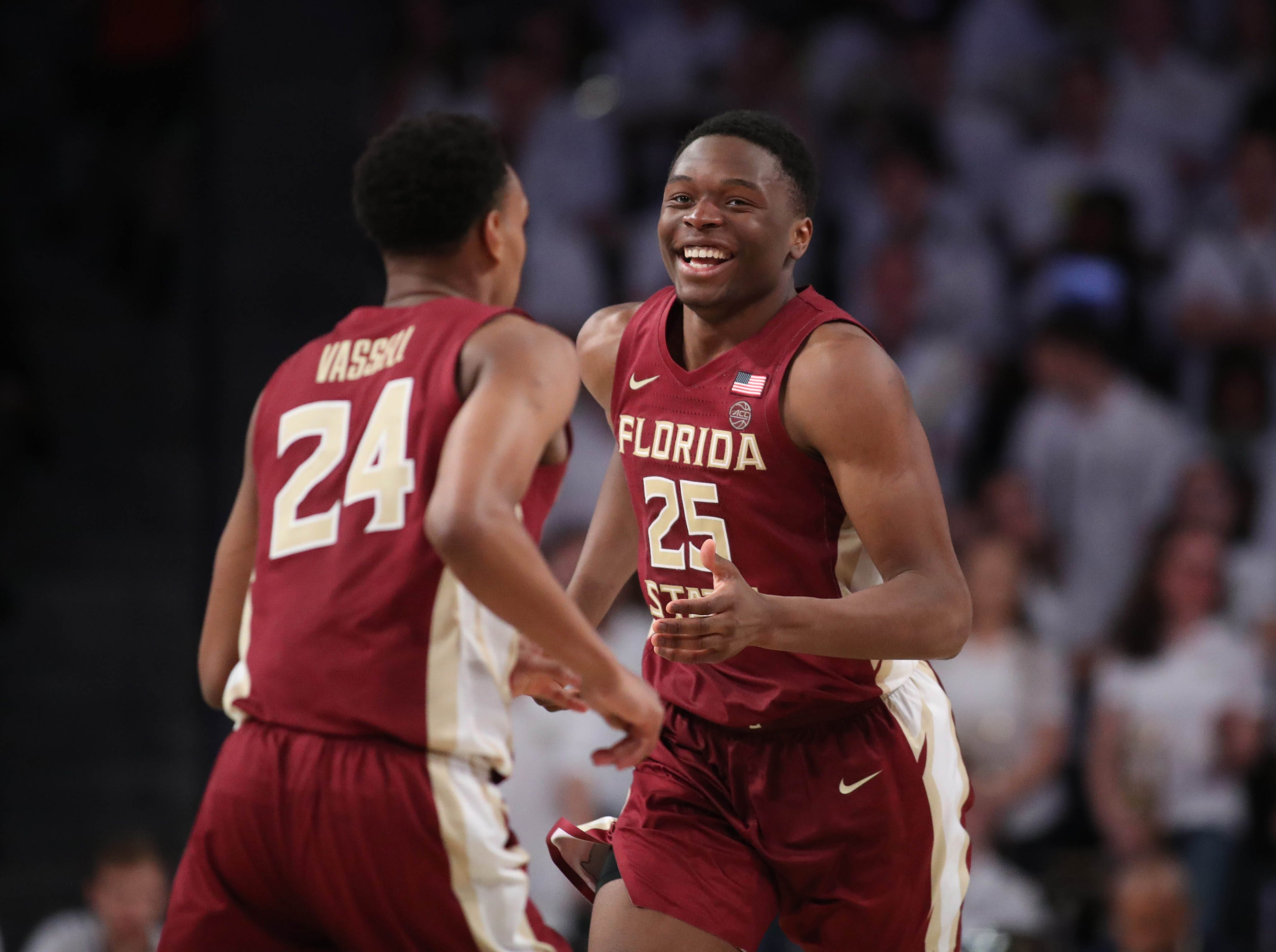 Feb 16, 2019; Atlanta, GA, USA; Florida State Seminoles forward Mfiondu Kabengele (25) celebrates a basket with guard Devin Vassell (24) in the second half against Georgia Tech Yellow Jackets at McCamish Pavilion. Mandatory Credit: Jason Getz-USA TODAY Sports
