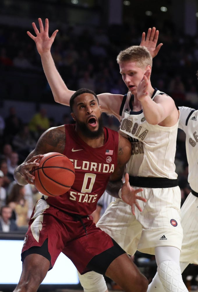 Feb 16, 2019; Atlanta, GA, USA; Florida State Seminoles forward Phil Cofer (0) drives against Georgia Tech Yellow Jackets forward Kristian Sjolund (35) in the first half at McCamish Pavilion. Mandatory Credit: Jason Getz-USA TODAY Sports