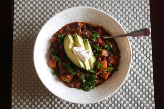 A bowl of sweet potato black bean chili, a heart healthy recipe prepared by Anna Jones, a local dietician and nutritionist, Friday Feb. 15, 2019.