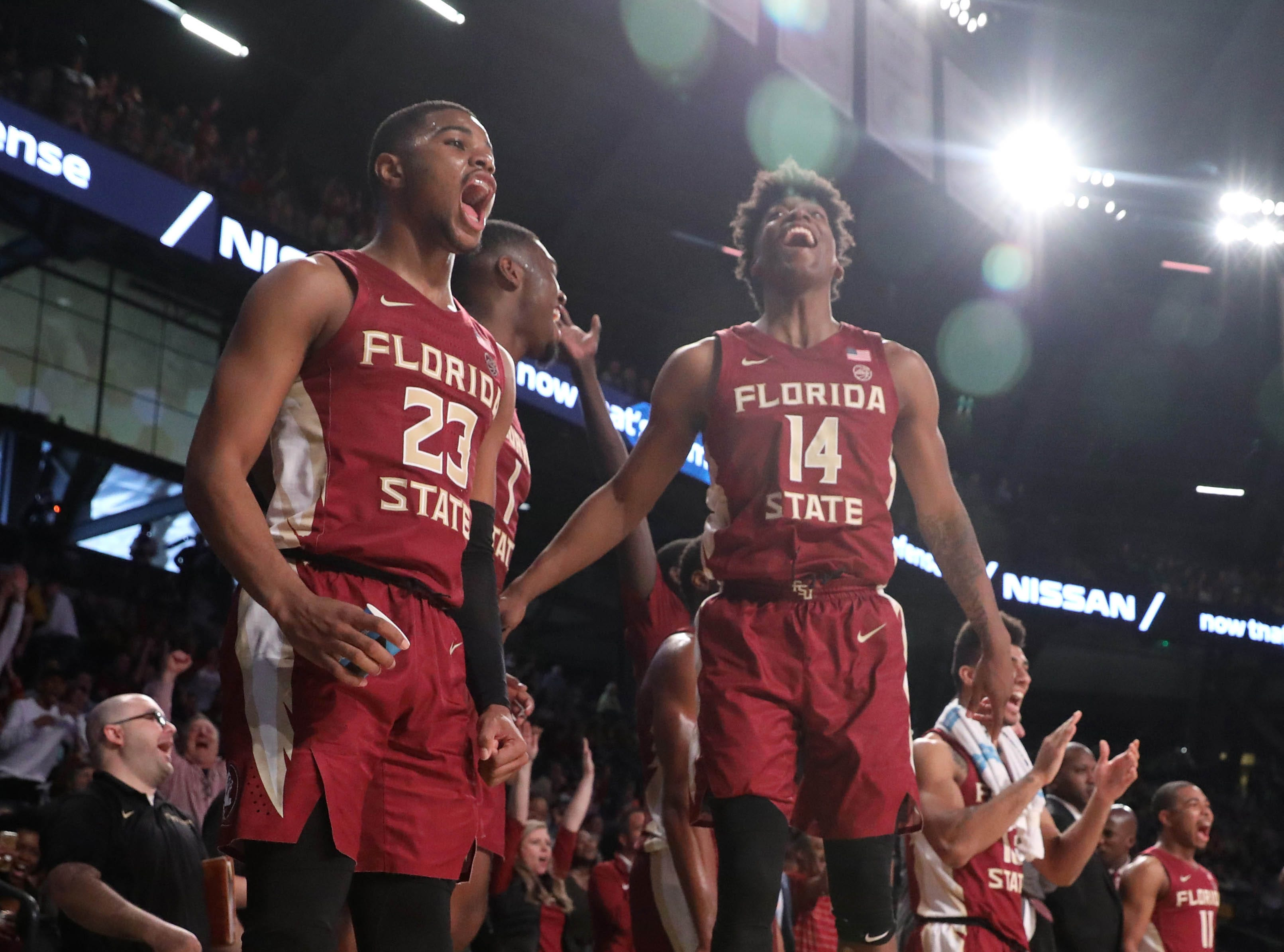 Feb 16, 2019; Atlanta, GA, USA; Florida State Seminoles guard M.J. Walker (23), guard Terance Mann (14), and others celebrate on the bench after a basket by a teammate in the second half against the Georgia Tech Yellow Jackets at McCamish Pavilion. Mandatory Credit: Jason Getz-USA TODAY Sports
