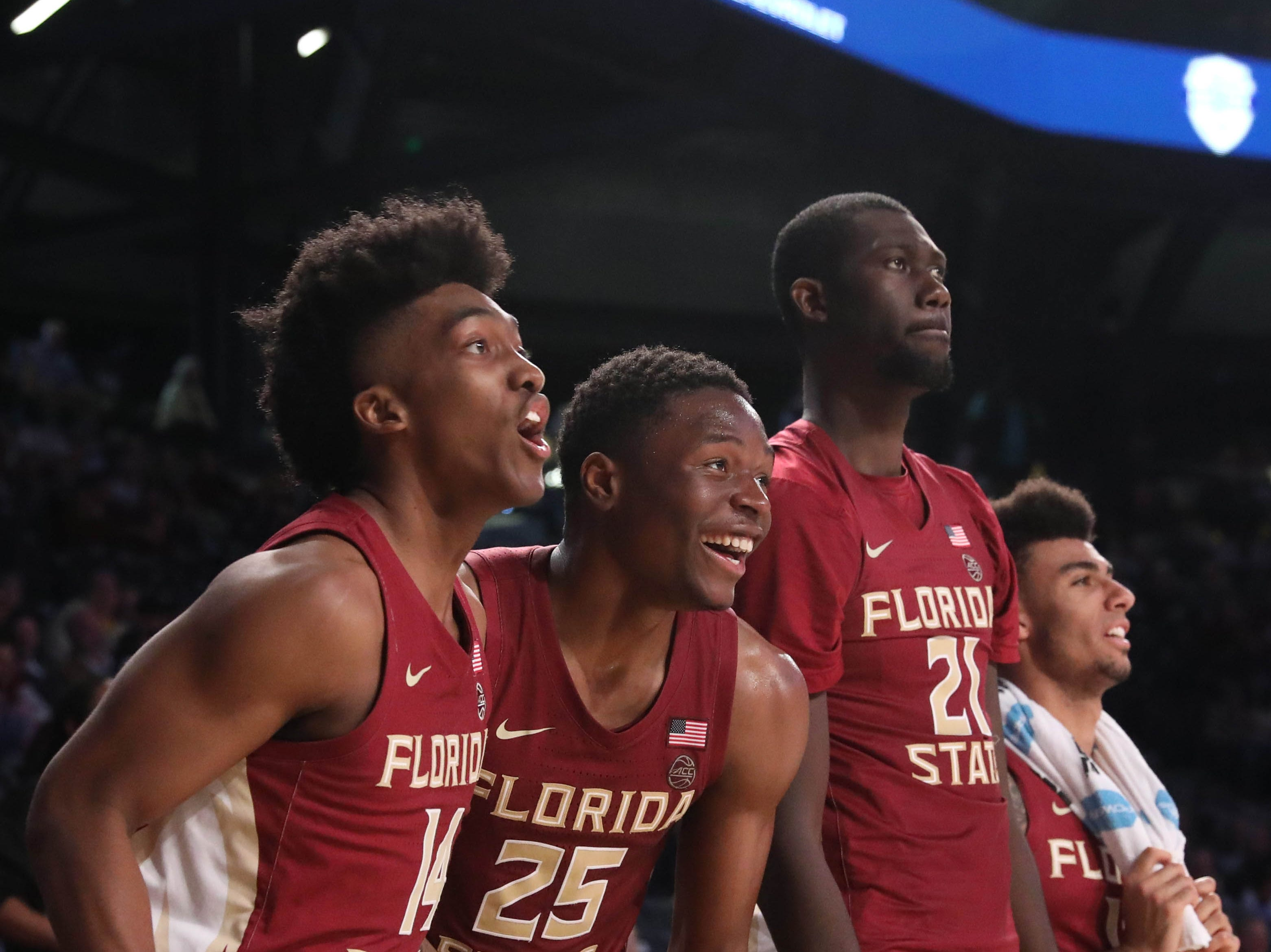 Feb 16, 2019; Atlanta, GA, USA; Florida State Seminoles guard Terance Mann (14), forward Mfiondu Kabengele (25), and center Christ Koumadje (21) celebrate on the bench in the second half against the Georgia Tech Yellow Jackets at McCamish Pavilion. Mandatory Credit: Jason Getz-USA TODAY Sports