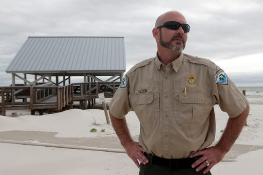 Josh Hodson, a park ranger at St. George Island State Park, stands in front of a damaged pavilion as he talks about what has been done to clean up the park, Tuesday Feb. 19, 2019. The park was damaged by Hurricane Michael in Oct. 2018.