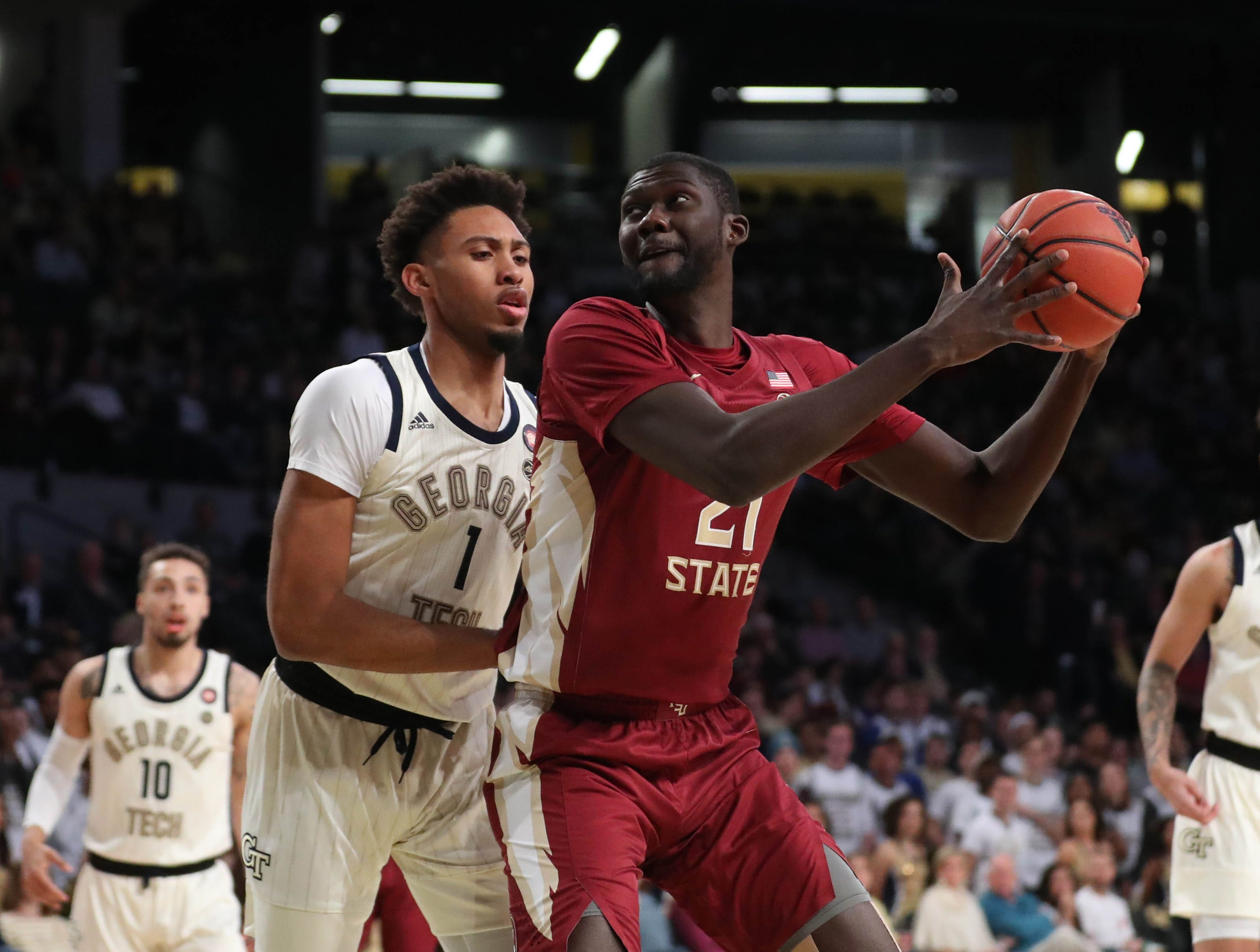 Feb 16, 2019; Atlanta, GA, USA; Florida State Seminoles center Christ Koumadje (21) makes a move against Georgia Tech Yellow Jackets forward James Banks III (1) in the first half at McCamish Pavilion. Mandatory Credit: Jason Getz-USA TODAY Sports