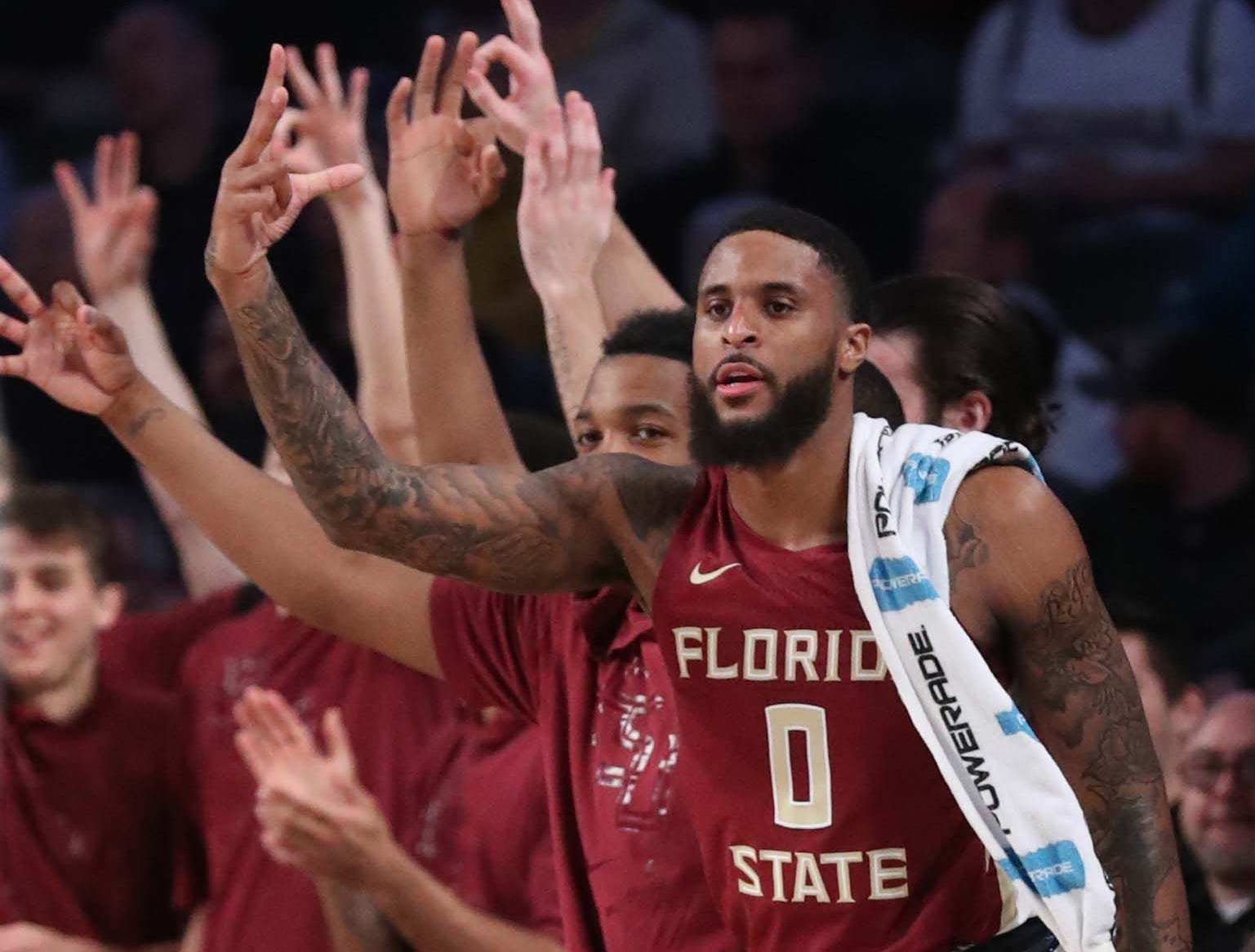 Feb 16, 2019; Atlanta, GA, USA; Florida State Seminoles forward Phil Cofer (0) celebrates a basket by a teammate on the bench in the first half against the Georgia Tech Yellow Jackets at McCamish Pavilion. Mandatory Credit: Jason Getz-USA TODAY Sports