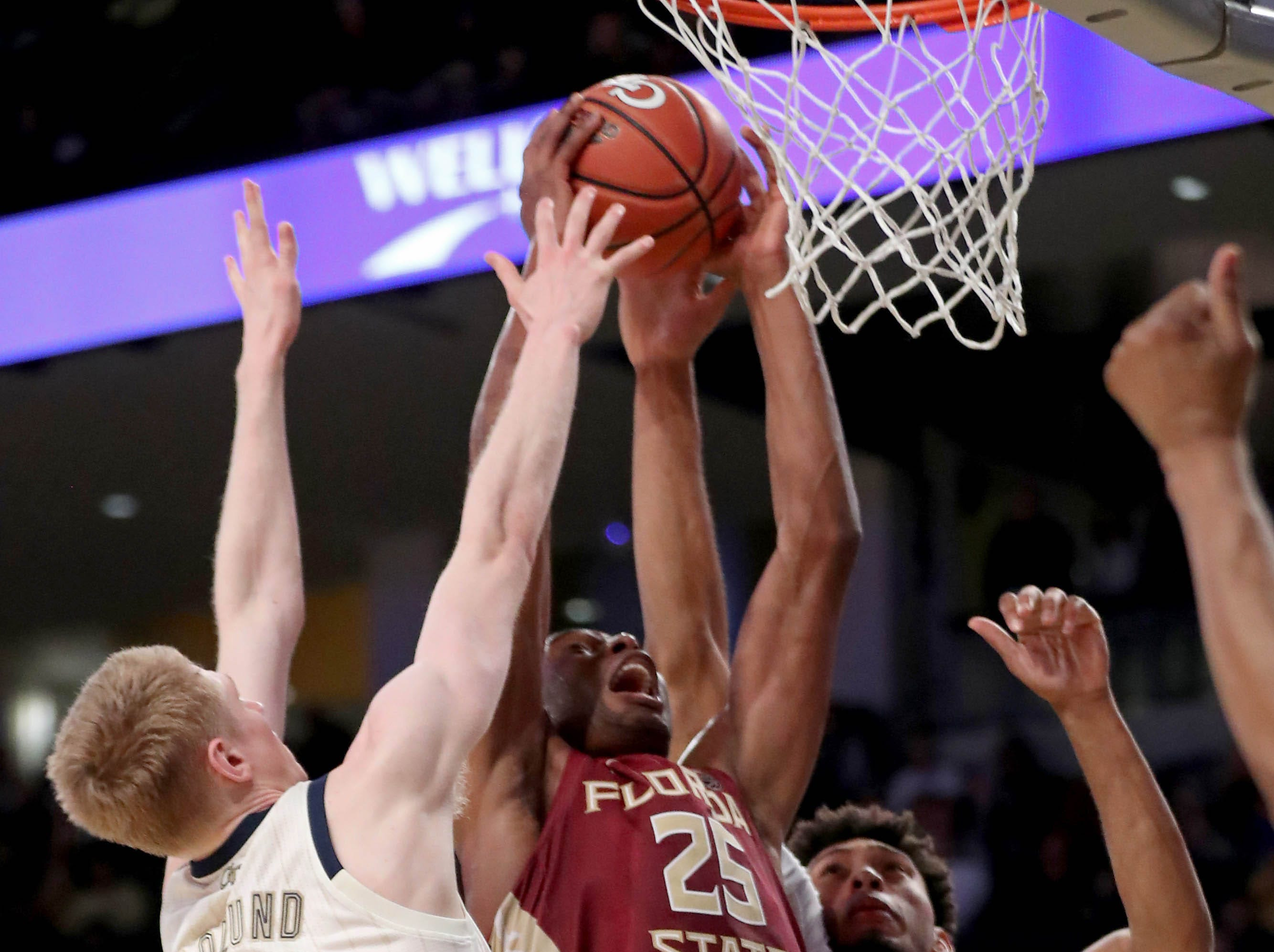 Feb 16, 2019; Atlanta, GA, USA; Florida State Seminoles forward Mfiondu Kabengele (25) attempts a shot against Georgia Tech Yellow Jackets forward Kristian Sjolund (35) and forward James Banks III (1) in the second half at McCamish Pavilion. Mandatory Credit: Jason Getz-USA TODAY Sports